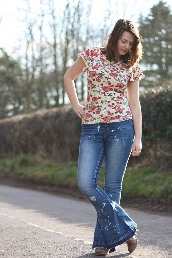 floral tee with flared jeans