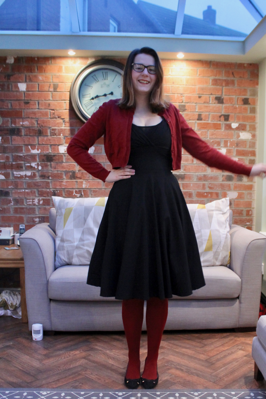 Collectif dress with red tights & cardigan