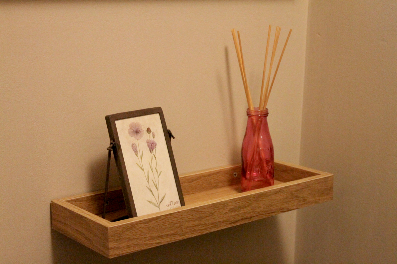 Downstairs Bathroom renovation: after - photo frame & reed diffuser
