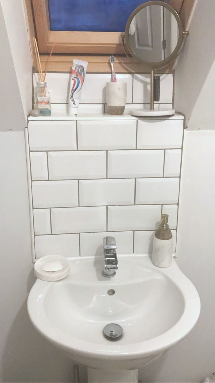 Subway bathroom tiles with marble accessories