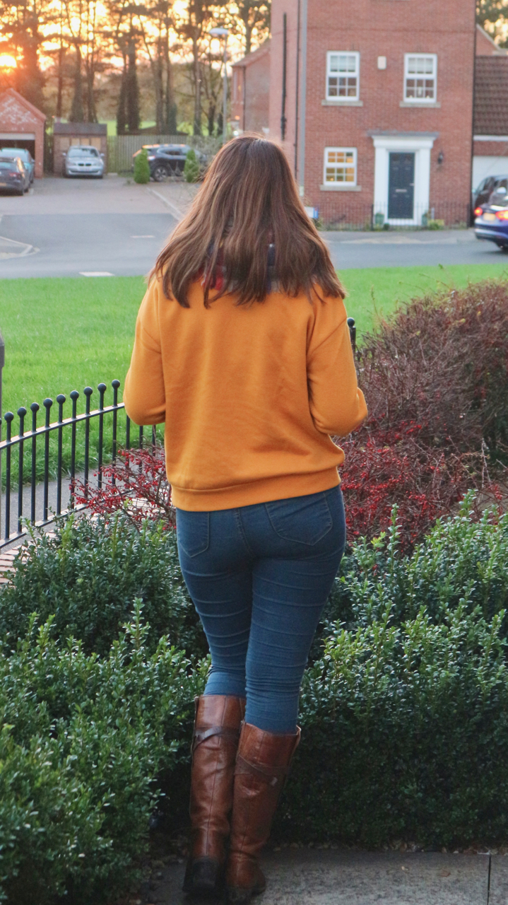 Primark mustard wild mountain jumper outfit with jeans