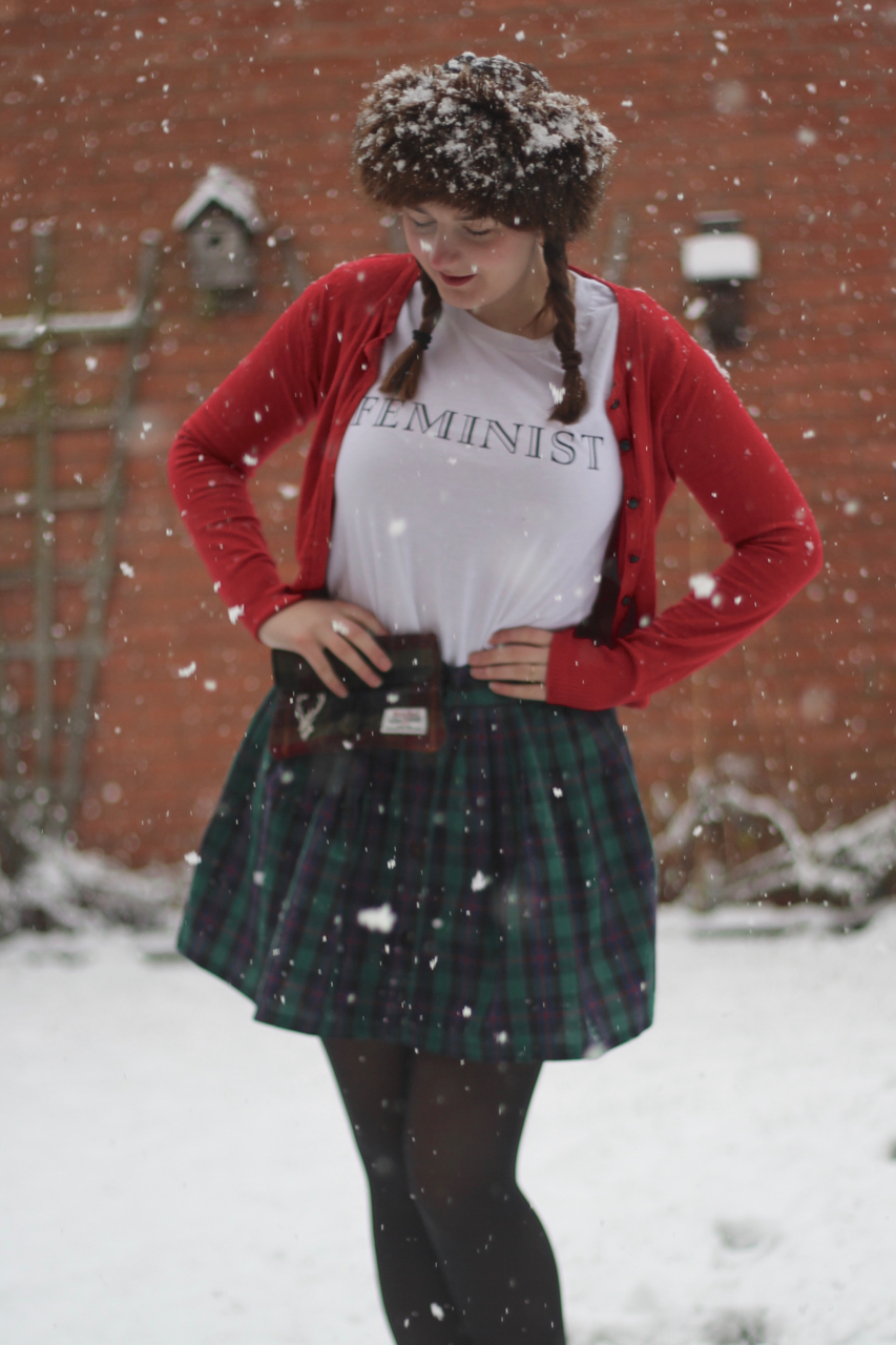 Vintage tartan skirt with feminist slogan tee outfit in the snow