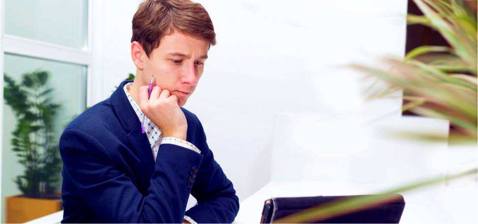 Young man in a suit studying