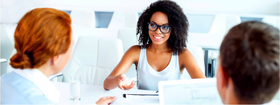Young woman having interview with two employers