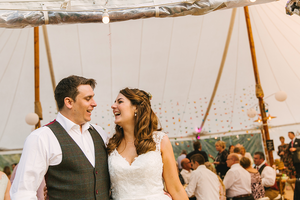 Inside sailcloth marquee by Shades Canvas with origami cranes wedding