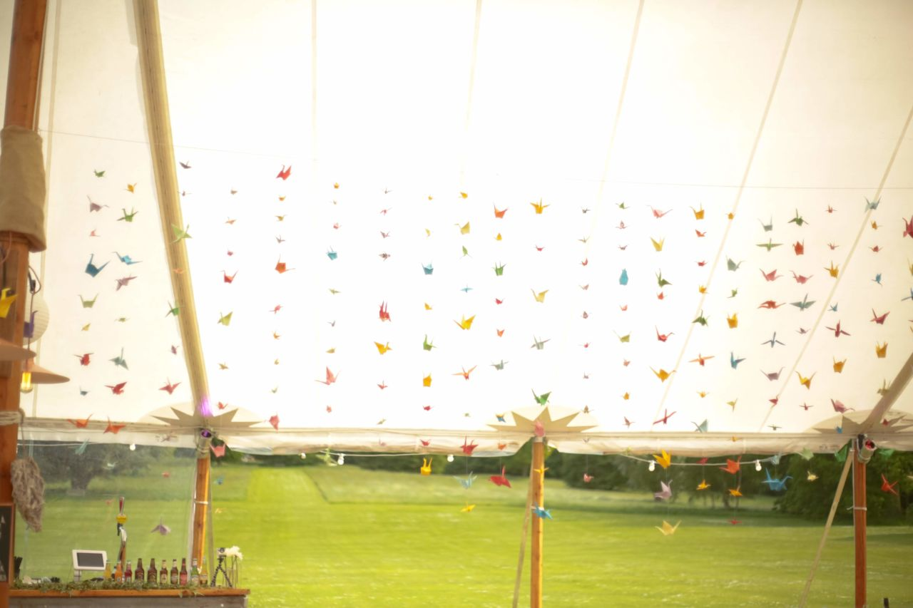 Sailcloth marquee wedding with 1000 origami cranes