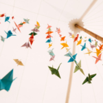 Origami Cranes in sailcloth marquee at Newburgh Priory wedding