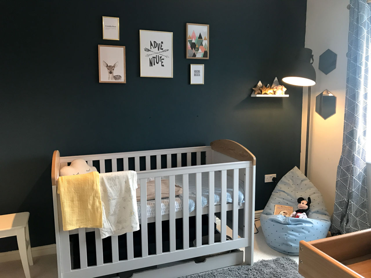 Adventure & nature inspired girl's nursery with woodland, forest & mountain elements - a wanderlust nursery with navy wall