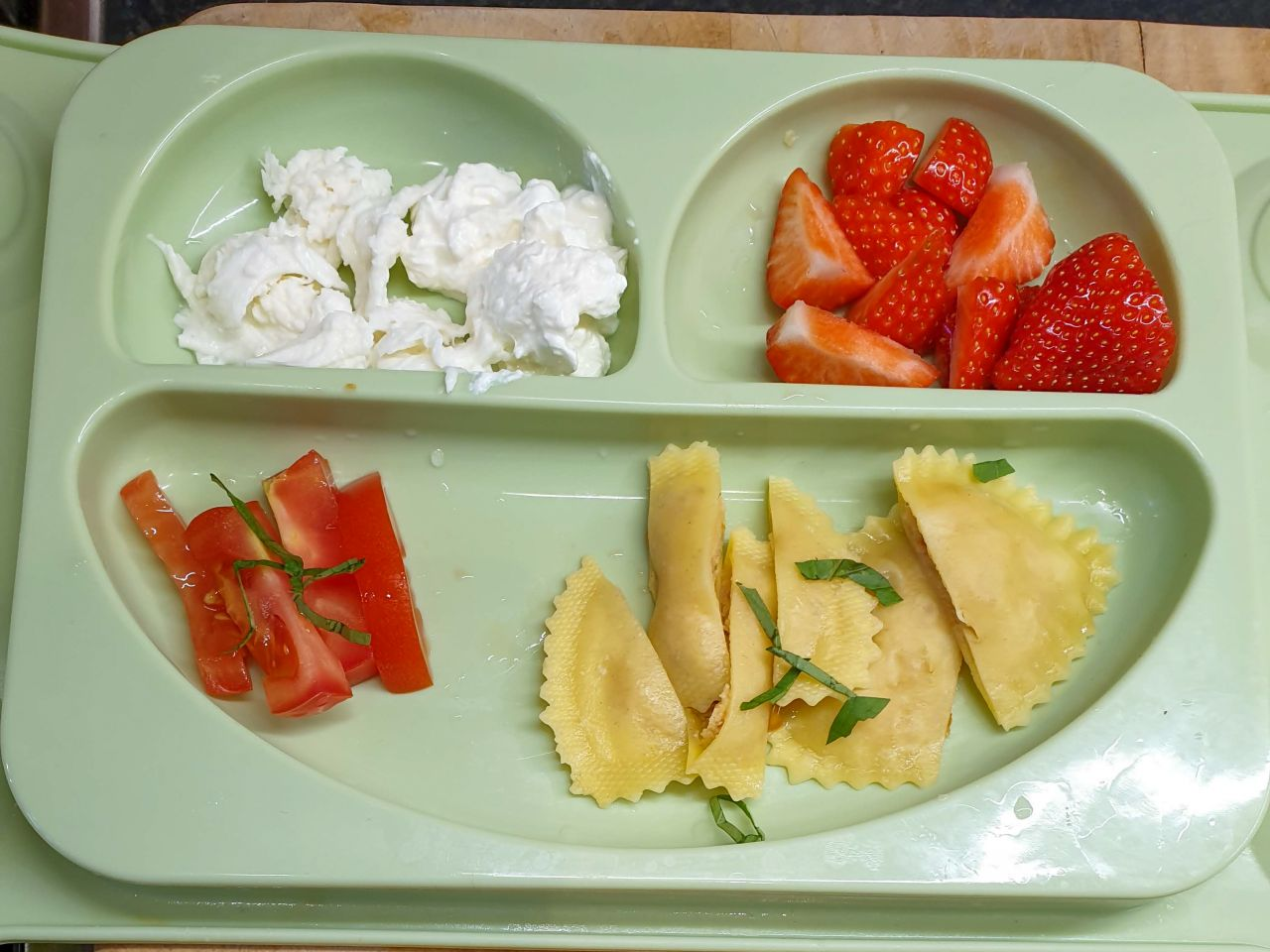 baby led weaning meal - filled pasta with tomatoes, mozzarella and strawberries