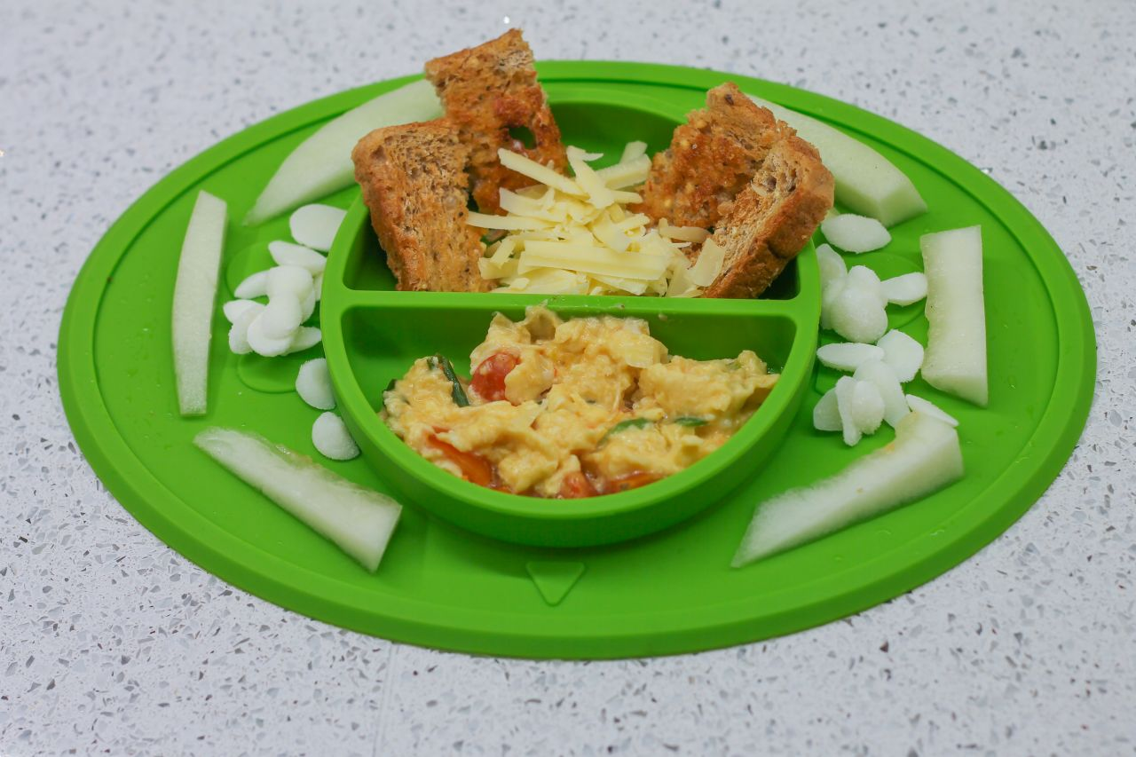 Baby led weaning breakfast - omelette with shredded cheese, toast and melon